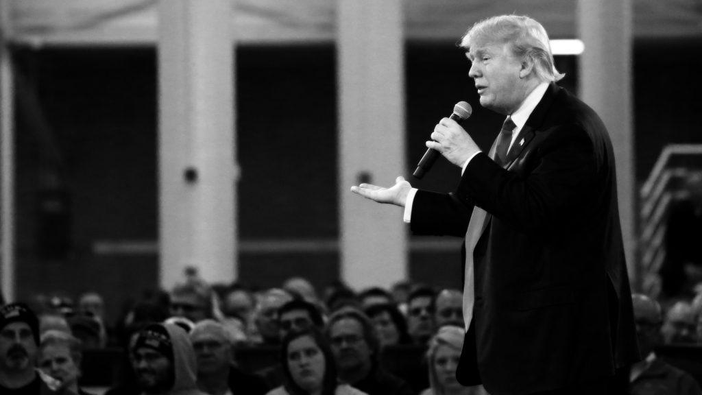 president donald trump giving a speech on a platform