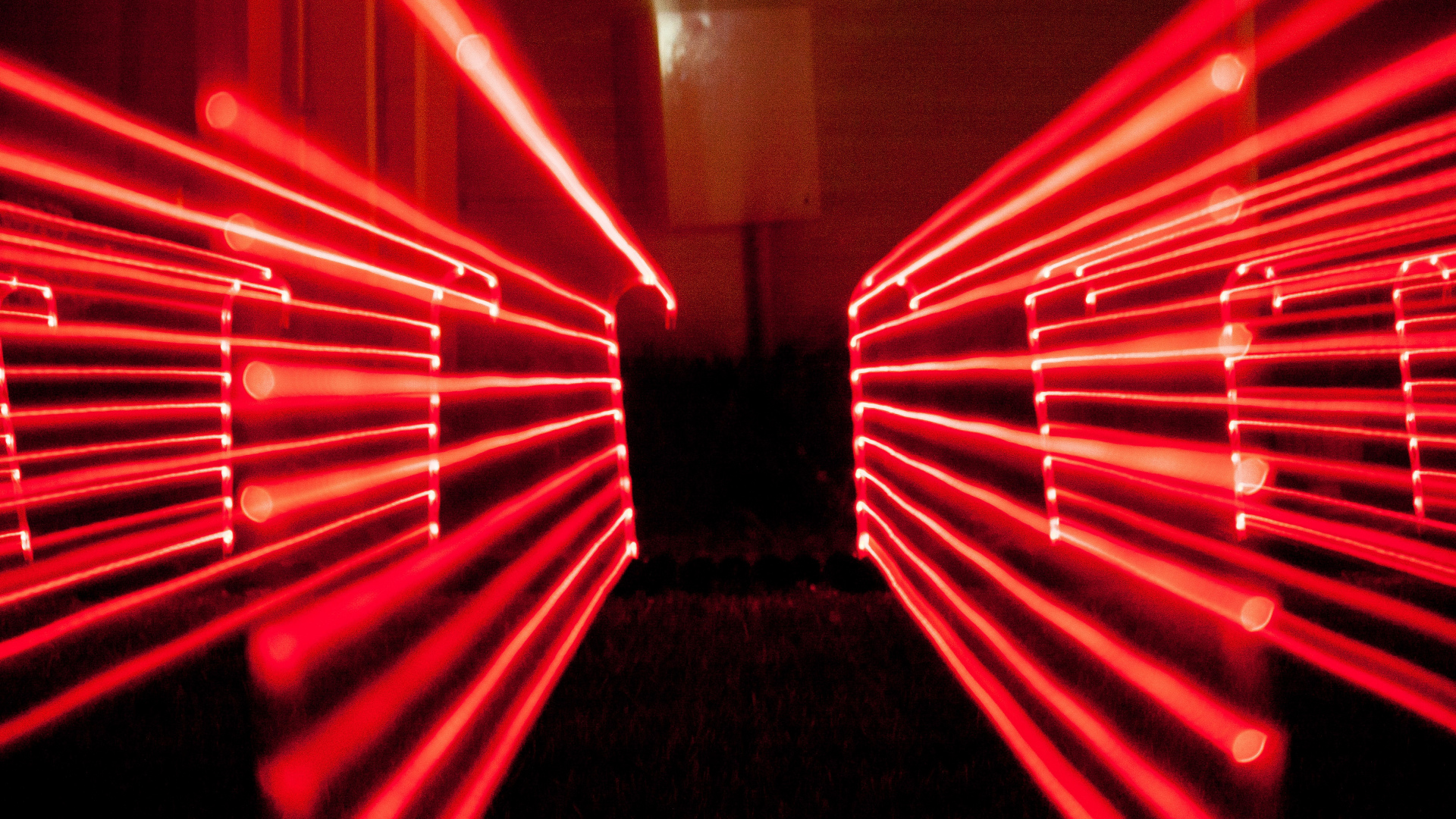 led candy canes streaking red light like a laser fence